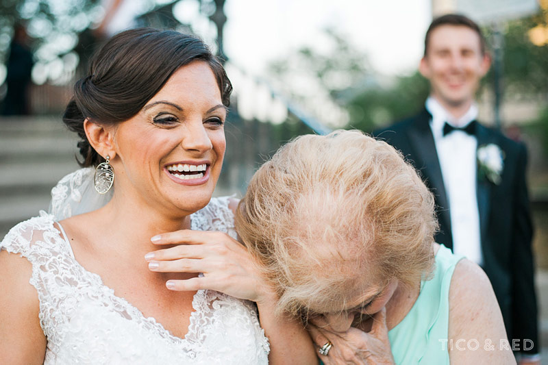 Grandmother and bride laugh together