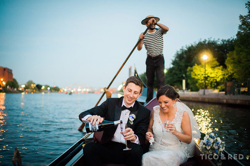 Married couple popping champagne on a gondola
